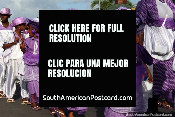 Kids dressed in purple and white, some with fans, the Avondvierdaagse parade in Paramaribo, Suriname. (720x480px). The 3 Guianas, South America.