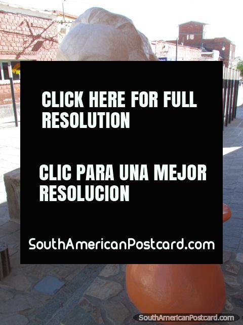 White head and orange jug sculptures in La Quiaca, Belgrano pedestrian walkway. (480x640px). Argentina, South America.