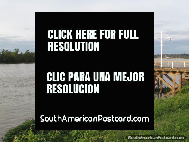 Fishing off a wharf on the Rio Parana in Parana. (640x480px). Argentina, South America.