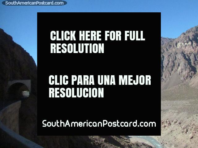 Along a road through a tunell on the mountains edge above the valley between Cristo Redentor and Mendoza. (640x480px). Argentina, South America.
