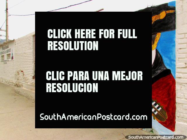 Guitarist plays his music, fantastic wall mural in Cafayate. (640x480px). Argentina, South America.