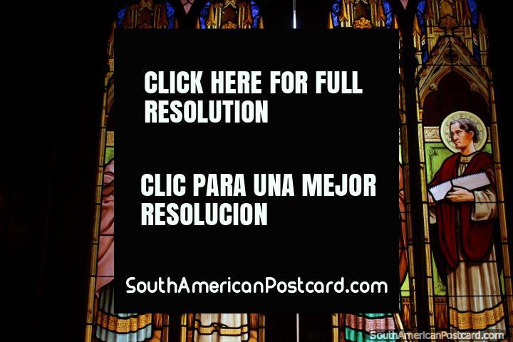 Stained glass and wooden doors of Parroquia San Juan Bautista de la Merced, religious figures, Salta. (720x480px). Argentina, South America.