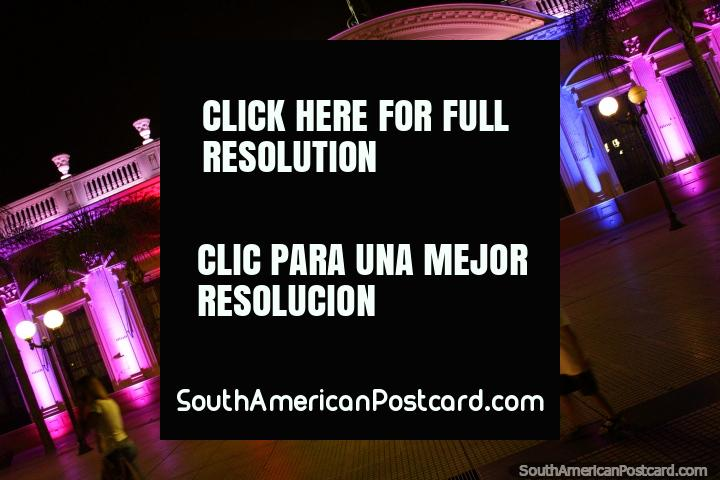 Fantastic pink, blue, purple and red lighting of the government building in the main plaza of Posadas at night. (720x480px). Argentina, South America.