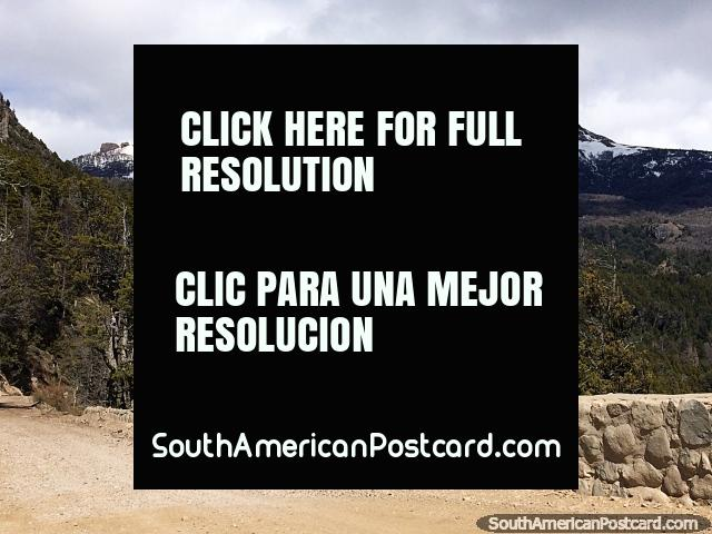 A beautiful landscape during the drive along Route 65 to Traful with snow-capped mountains and forest. (640x480px). Argentina, South America.