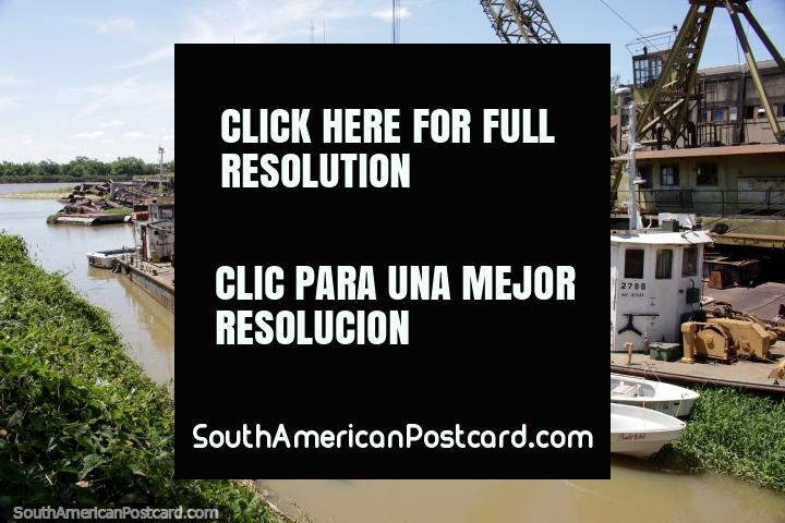 Port area in Parana with boats and cranes, the Parana River. (720x480px). Argentina, South America.