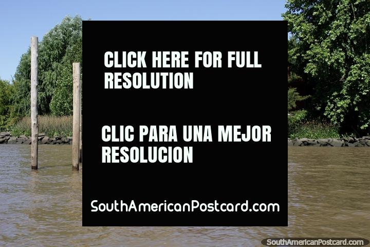 Large wooden house and newly built jetty beside the river in Tigre, Buenos Aires. (720x480px). Argentina, South America.