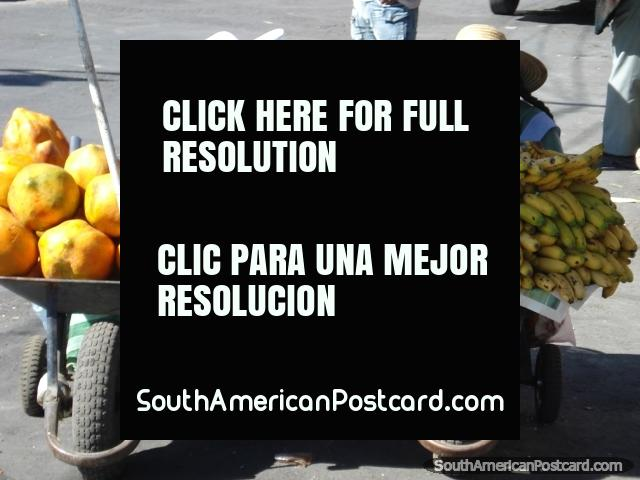 Melons and bananas in wheelbarrows being sold by 2 ladies in Cochabamba. (640x480px). Bolivia, South America.