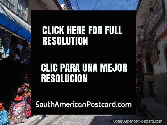 Cobblestone street and shops in La Paz. (640x480px). Bolivia, South America.