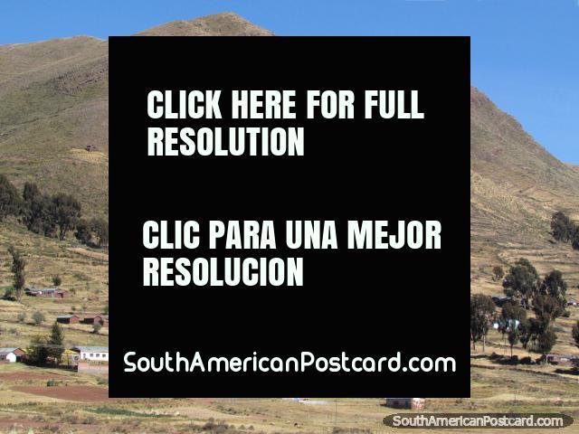 Big hills overlooking a community between Guaqui and Desaguadero. (640x480px). Bolivia, South America.