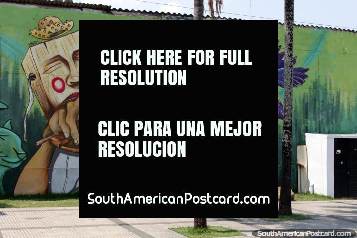 Man with a wooden head plays violin, fantastic mural in Santa Cruz. (720x480px). Bolivia, South America.