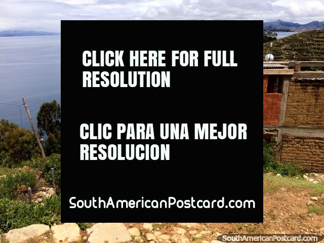 Sit down and have refreshments while enjoying spectacular views of Lake Titicaca, Island of the Sun, Copacabana. (640x480px). Bolivia, South America.