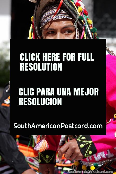 Male dancer dressed in pink with colorful headgear dances for an event in Potosi. (480x720px). Bolivia, South America.