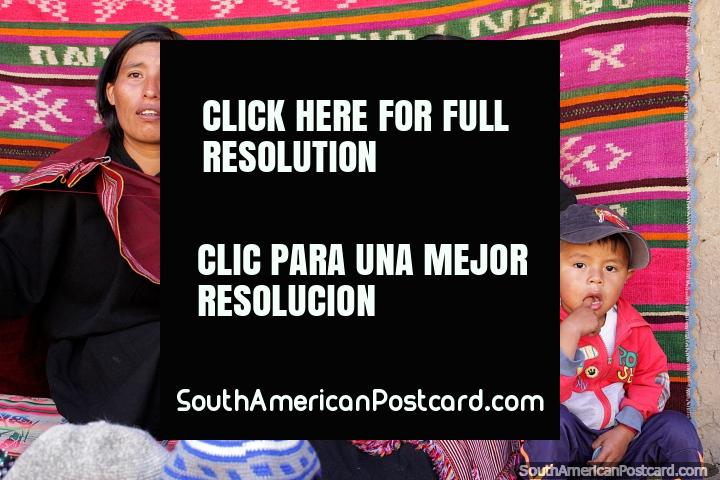 2 women of Puka-Puka weave fabric and woolly hats, indigenous people near Sucre. (720x480px). Bolivia, South America.