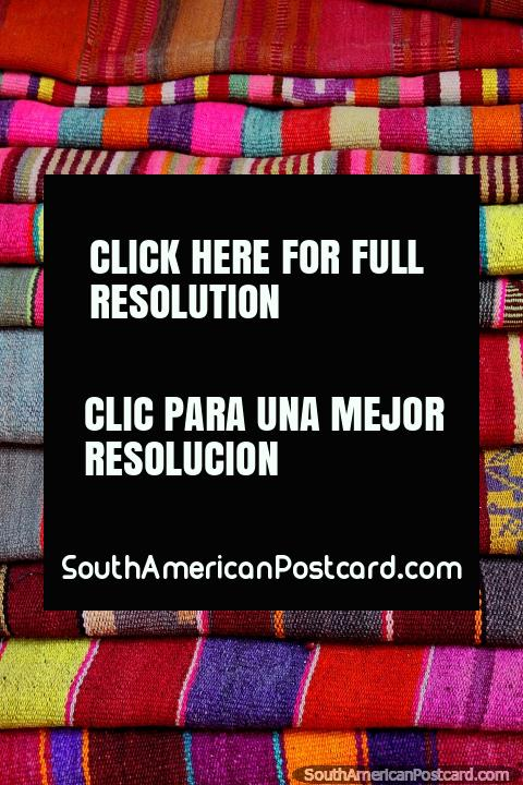 Traditional colors of blankets to wrap around you in the higher altitude in Tarabuco. (480x720px). Bolivia, South America.