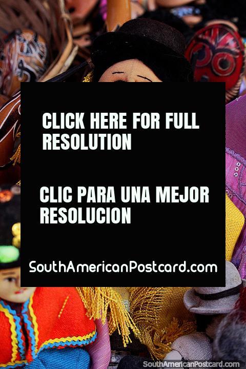 Hat lady doll, she wears a yellow shawl, souvenirs at Tarabuco market. (480x720px). Bolivia, South America.