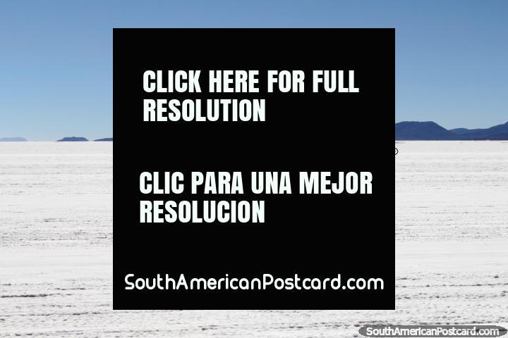 People riding bicycles across the crusty Uyuni salt flats, a hard task I imagine. (720x480px). Bolivia, South America.