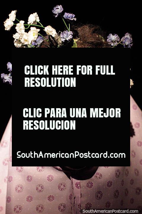 Black mask with flowers call Japutuqui, the dance Los Toritos, Beni region, Musef museum, La Paz. (480x720px). Bolivia, South America.