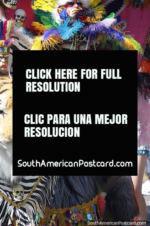 Costume from the planet of the apes with colorful feathers, animals attached, El Gran Poder, Sucre. (480x720px). Bolivia, South America.