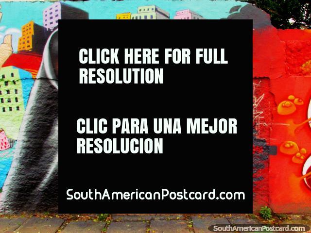 Child in black and colorful city wall mural in Porto Alegre. (640x480px). Brazil, South America.