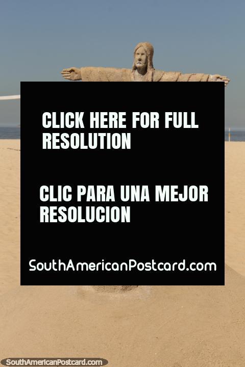 Christ the Redeemer made of sand at the beach in Copacabana, Rio de Janeiro. (480x720px). Brazil, South America.