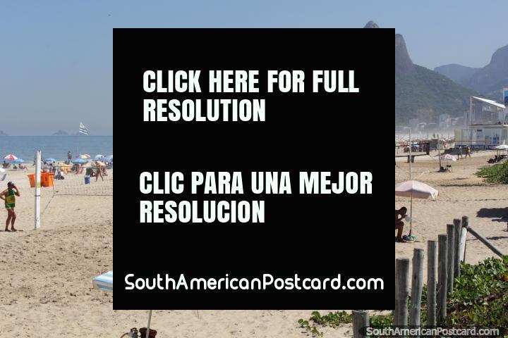 The crowds come to Ipanema beach for surf, sand and fun, Rio de Janeiro. (720x480px). Brazil, South America.
