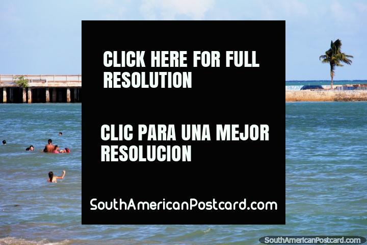 People swimming at the less crowded end of Pajucara Beach in Maceio. (720x480px). Brazil, South America.