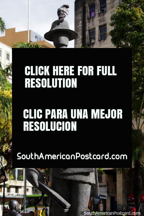 Fernando Pessoa (1888-1935), a Portuguese poet and writer, stone sculpture in Recife. (480x720px). Brazil, South America.