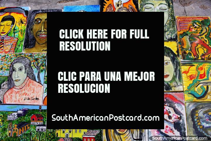 Estas pinturas de caras vendem-se na rua no cume de morro em Olinda. (720x480px). Brasil, América do Sul.