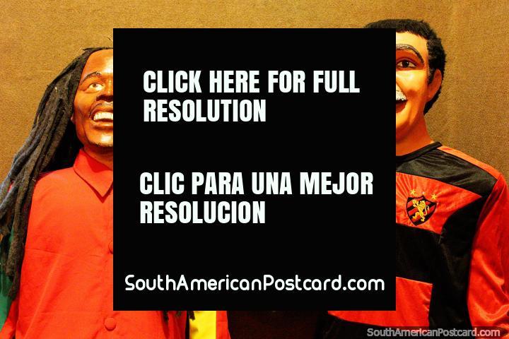 2 Bonecos, one with dreadlocks, listen to the radio, museum in Olinda. (720x480px). Brazil, South America.