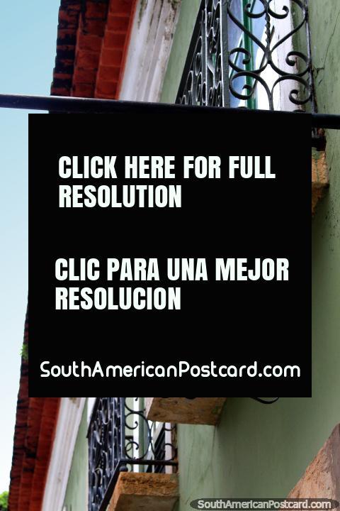 Poeme-Se Livros Usados, a tiled street sign in historic Sao Luis, iron balcony. (480x720px). Brazil, South America.