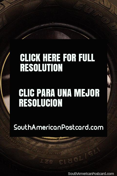 Euzkadi tire, an old man in a black hat, a rubber tapper, the rubber museum in Rio Branco. (480x720px). Brazil, South America.