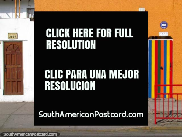 Garage, window and door painted in bright colors in Antofagasta. (640x480px). Chile, South America.