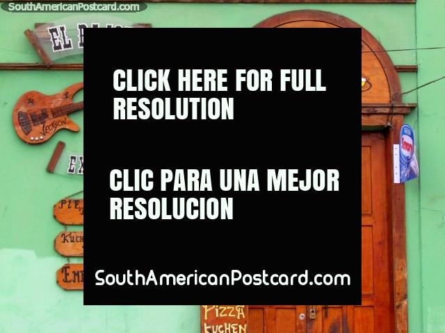Front facade of Cafe 'El Bajon', wooden door, guitar and signs, Coquimbo. (640x480px). Chile, South America.