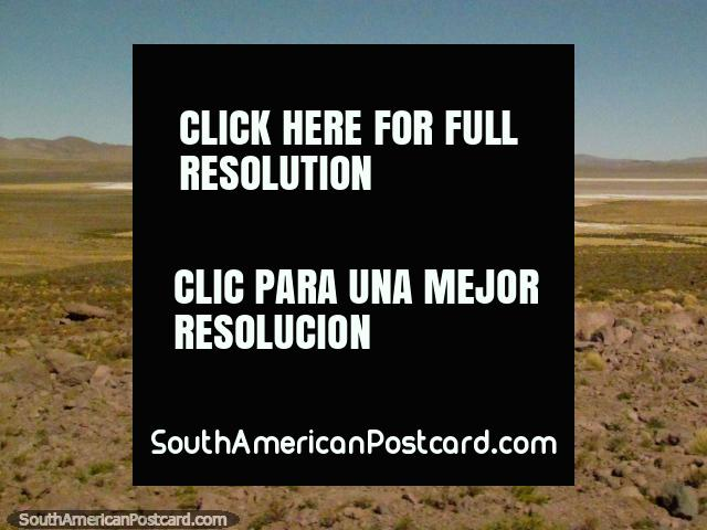 Salty plains and a small lagoon between Paso de Jama and San Pedro. (640x480px). Chile, South America.