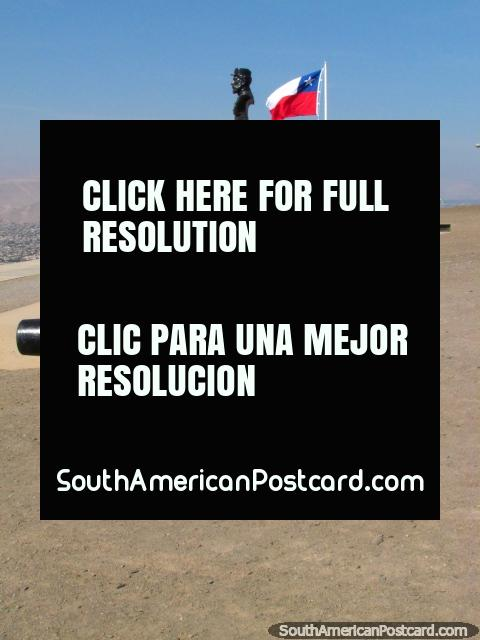 Cannon, flag, bust, another view at El Morro de Arica hill. (480x640px). Chile, South America.