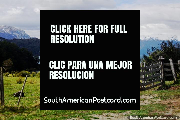 Great view of Lake General Carrera with a wooden fence and gate on grassland at Puerto Rio Tranquilo. (720x480px). Chile, South America.