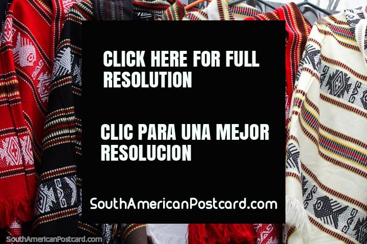 Red, brown and white ponchos with traditional designs, made in Castro. (720x480px). Chile, South America.