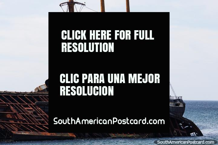 Shipwreck with 4 masts in view rusting in the waters of Punta Arenas. (720x480px). Chile, South America.