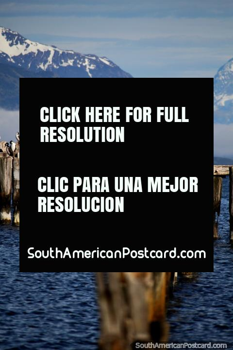 The old pier, waters and snow-capped mountains in Puerto Natales. (480x720px). Chile, South America.