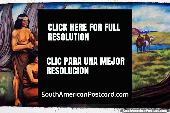 Indígenas alrededor de una laguna y árboles cerca de Torres del Paine, mural de Eladio Godoy Vera en Puerto Natales. (720x480px). Chile, Sudamerica.