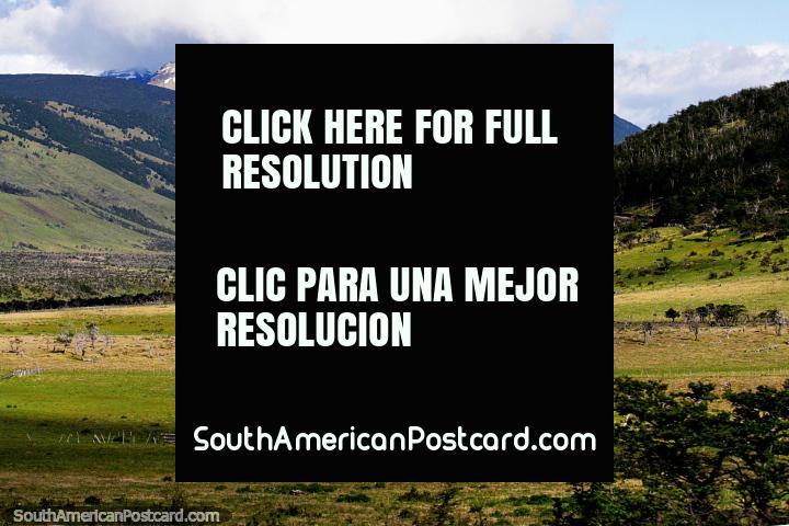 A tabletop mountain range with snow and the green terrain near Villa Cerro Castillo. (720x480px). Chile, South America.