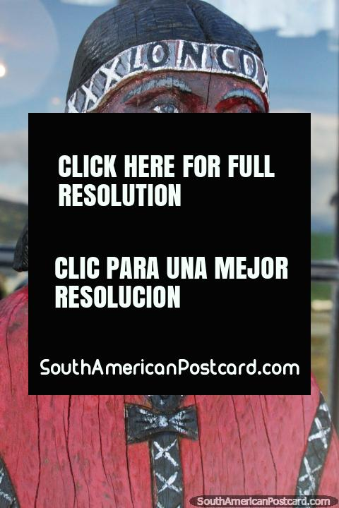 2nd wooden sculpture of an indigenous Indian at Villa Cerro Castillo. (480x720px). Chile, South America.