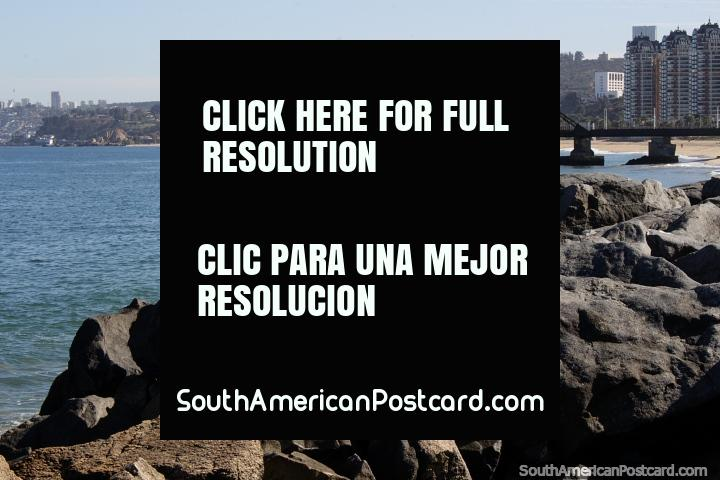 Wharf and beach with rocks in the foreground in beautiful Vina del Mar. (720x480px). Chile, South America.