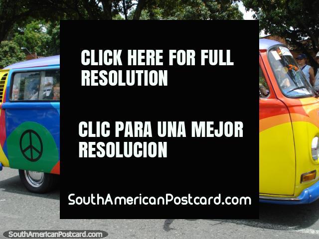 Hippie combi van in rainbow colors at Feria de las Flores in Medellin. (640x480px). Colombia, South America.