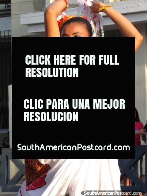 Dancing girl dressed in white and dark blue - Fiesta del Mar, Santa Marta. (480x640px). Colombia, South America.