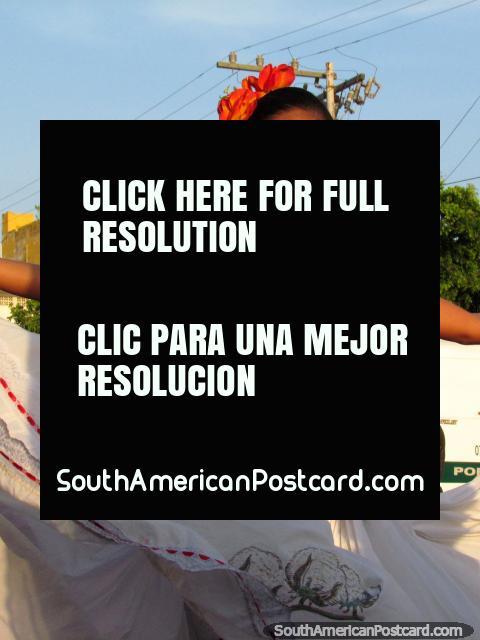 Beautiful dancing girl with orange flowers in hair - Fiesta del Mar, Santa Marta. (480x640px). Colombia, South America.