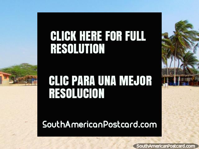 Restaurants under palm trees beside the white sandy beach in Camarones. (640x480px). Colombia, South America.