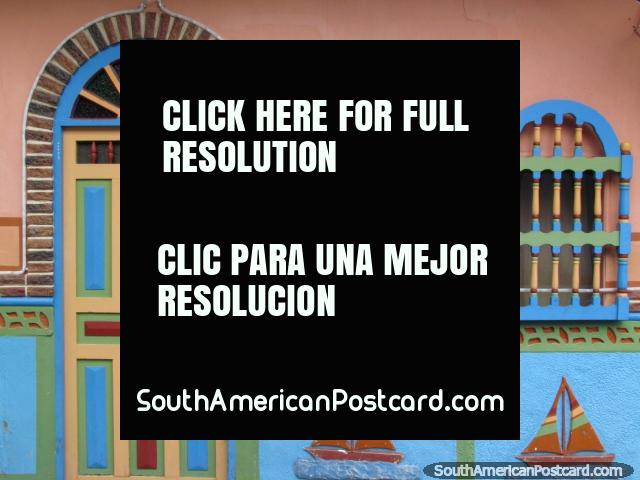 Sailboats decoration, wooden door and window shutters, blue, green and cream in Guatape. (640x480px). Colombia, South America.