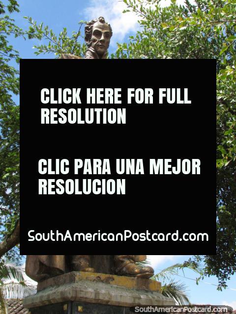Gold Simon Bolivar statue in the corner of Guatape plaza. (480x640px). Colombia, South America.