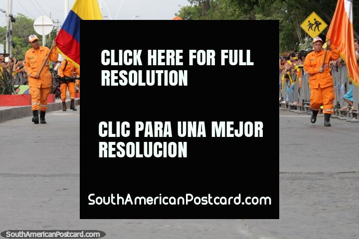 The Civil Defense Force dressed in bright orange at the Festival of the Sea in Santa Marta. (720x480px). Colombia, South America.